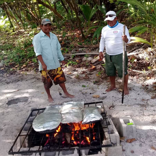 Belize-Guide-Co-open-flame-bbq-fish