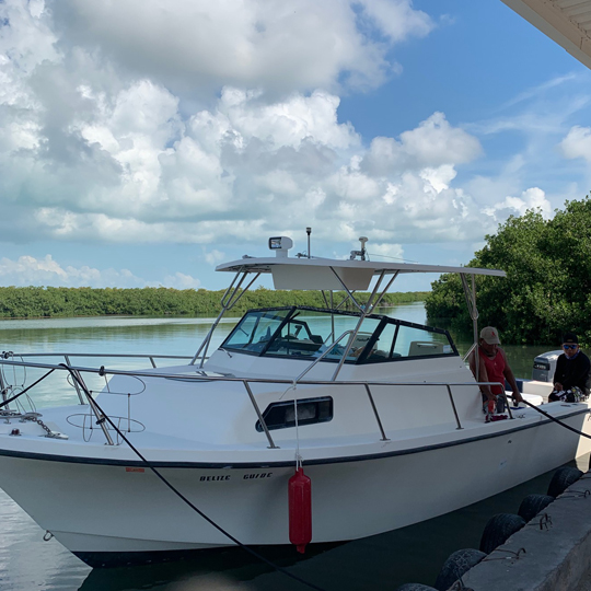 Belize-Guide-Co-parker-boat-docked